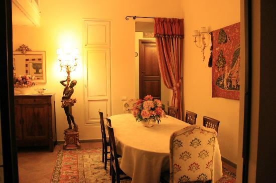 La Casa del Garbo: this was the breakfast area, our room was behind the curtain up the stairs