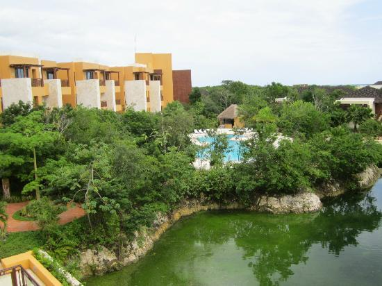 Fairmont Mayakoba: view from the lobby of one pool and one building of guest rooms