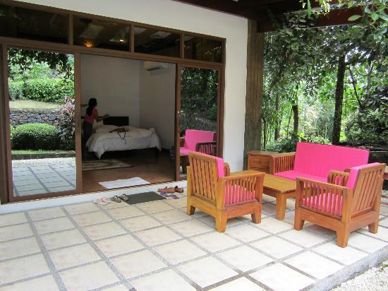 Cintai Corito's Garden: Terrace and bed of villa