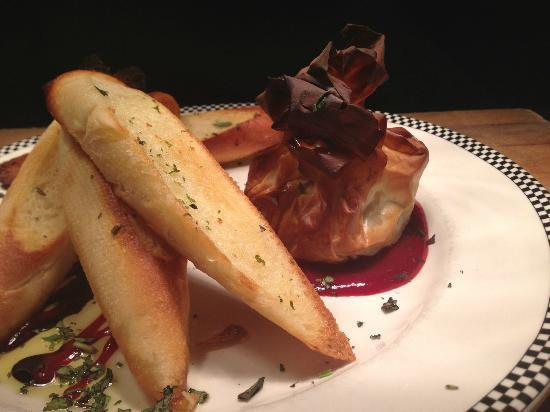 Louie's Steakhouse and Lounge: Baked Brie wrapped in Filo with Raspberry Coulis