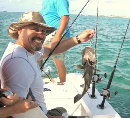 We sell logo t shirts too picture of go fish fishing for Playa del carmen fishing charters