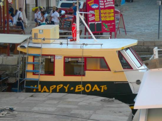"Villa Mozart: one of the boats that docks at night ""Happy Boat"""