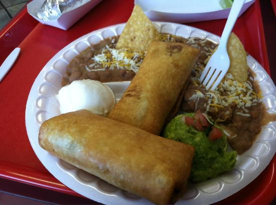 Chimichangas at Las Barcas with side of beans, sour cream and guacamole.