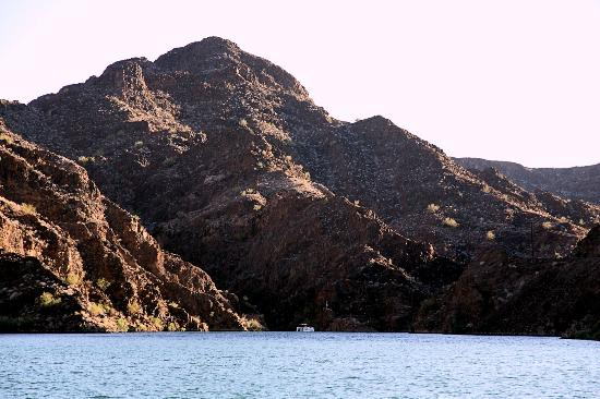 London Bridge Resort: The mountains surrounding this cove dwarf the boat shown below. The shore line can be deceiving.