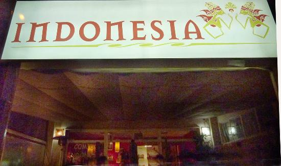 Restaurante Indonesia: Lona at the entrance awaiting her customers
