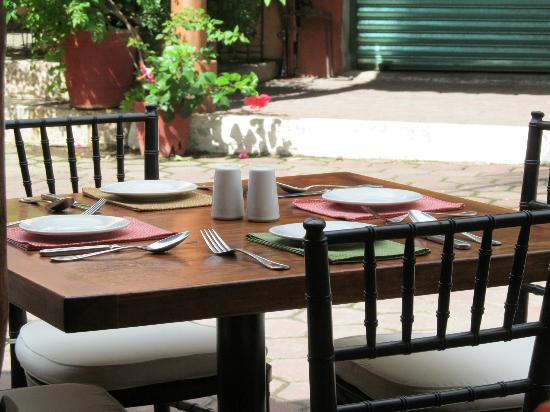 Piazza D'Angelo: A beautiful outside bistro table looking out onto the palm lined street