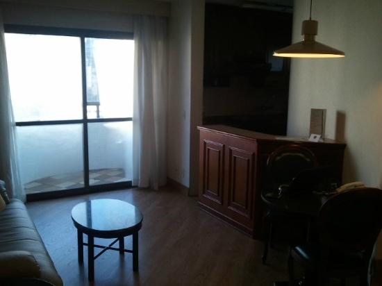 Paulista Wall Street Suites: Liviing room, Balcony and Kitchen.