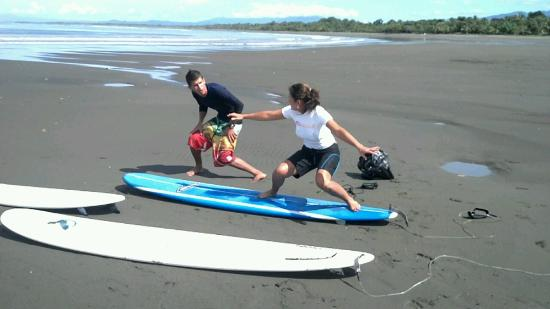 "Tropical Surf School: Turns out all three of us were ""goofy foot"" - perfect since the waves were peeling left all morn"