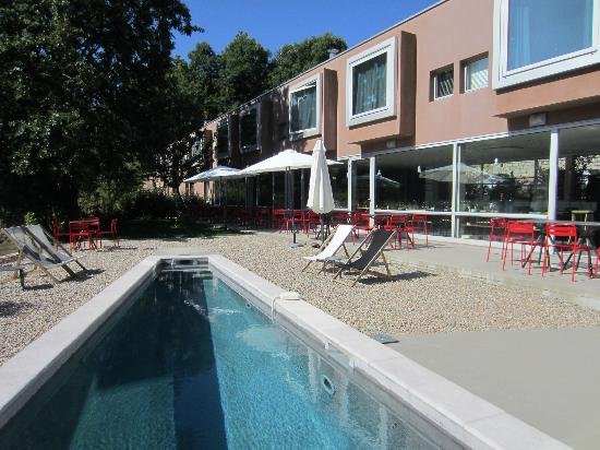 Pool garden picture of boutique hotel artemisia for Boutique hotel artemisia