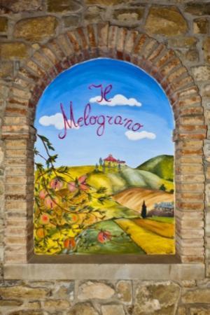 La Casa del Melograno: ll Logo