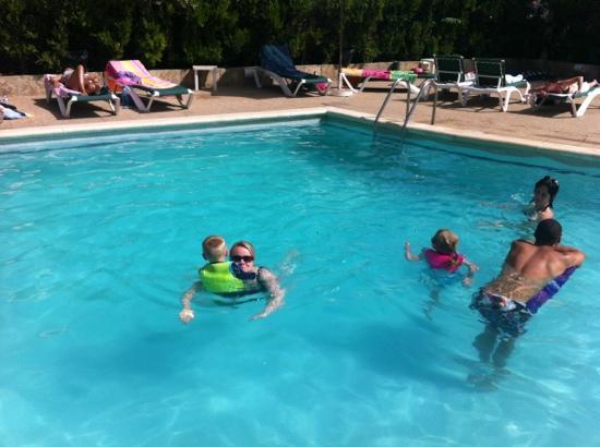 Martha's Apartments: The kids enjoying the pool