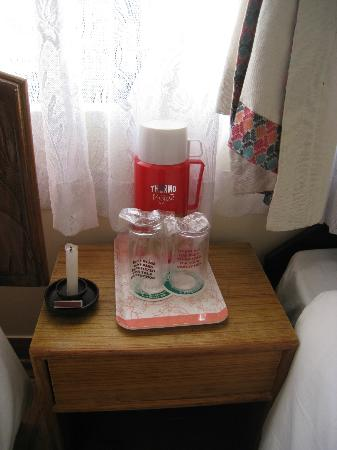 Thamel Eco Resort: Candle and thermos of cold water