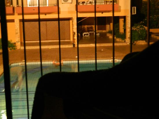 Anthea Hotel Apts: drunk man swimming in pool with all the dirt in it