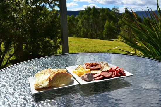 The Heavens Mountain Escape : Enjoying a platter of yummy food one the deck in the sun.