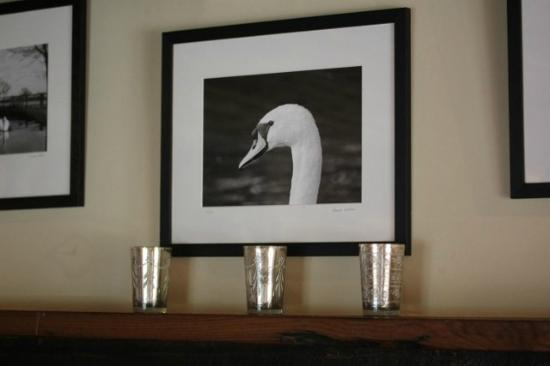 The Swan at Southrop: Swan photos on the mantelpiece