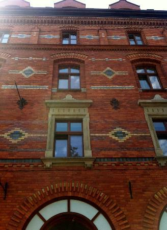 outside picture of red brick apartments krakow