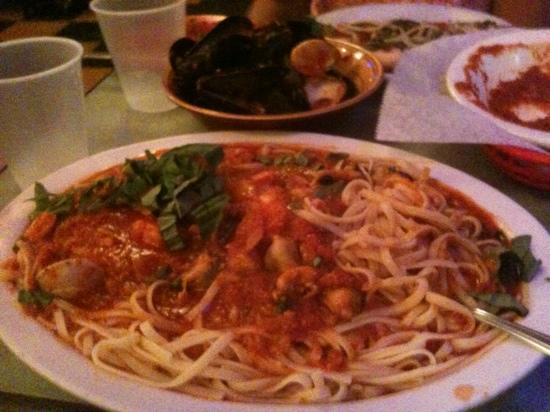 Italian Express Pizzeria : Frutti di Mare (with shells from all the clams and mussels in the background) - Delicious! Huge