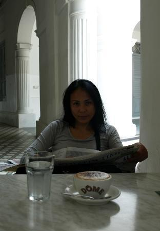 Olio Dome - Bras Basah: Reading the Straights Times Newspaper