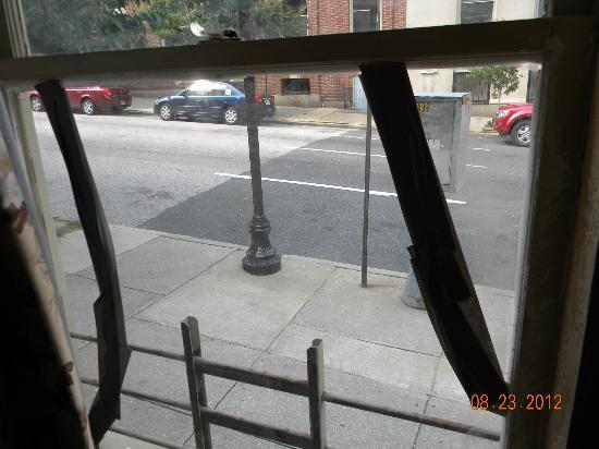 Midtown Inn: View from room. Broken glass with duct tape.
