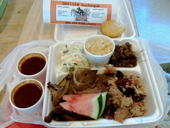Gorilla Barbeque: Two Meat Special (Brisket+Pulled Pork+sauce) Cole slaw, Beans & Rice, macNcheese, Cornbread Wate