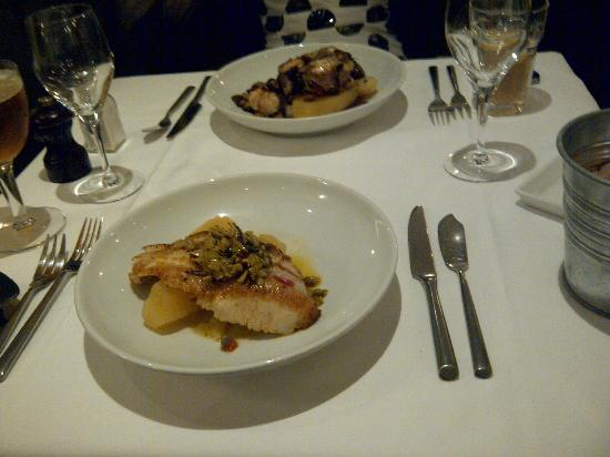 L'Ecume des Mers : turbot with potatoes with olives (closest) and monkfish with potatoes furthest.