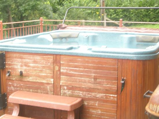 Hot tub on the balcony great size but needs a lick of for Balcony hot tub