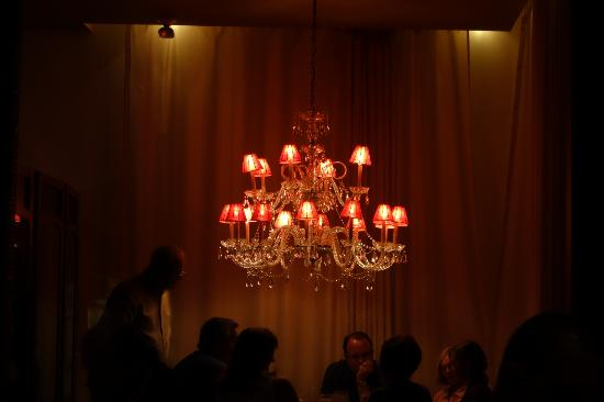 Odd Chandelier And Gauzy Walls For One Small Section Of Restaurant