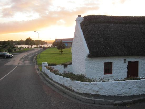 Lough Derg House: Thatch-roof cottage just in front, looking toward the lake