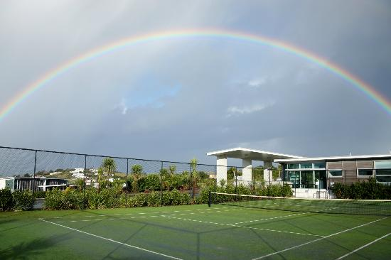 Doubtless Bay Villas: rainbow over tennis court