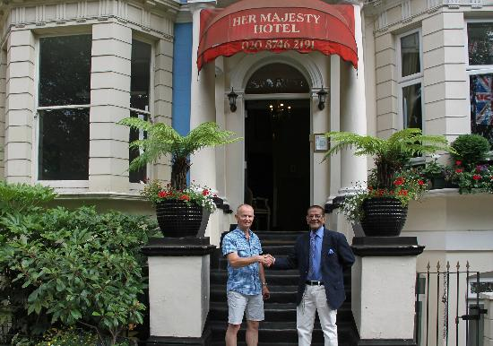 Her Majesty Hotel: Holger (the owner) and I saying goodbye for this time, outside the hotel