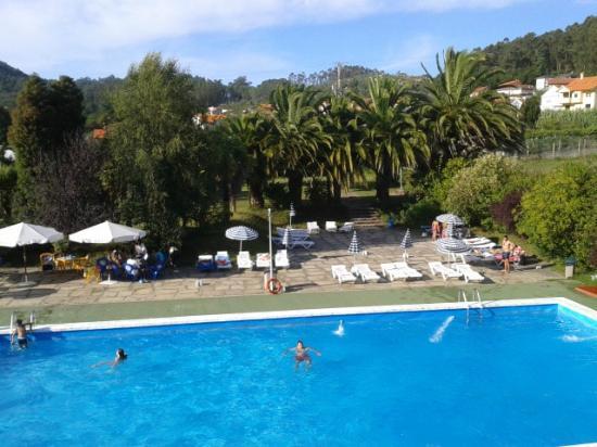 Don Hotel: Jardines del hotel y piscina de adultos desde el balcon de la habitacion