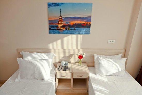 Trio Suites: Twin bed Room