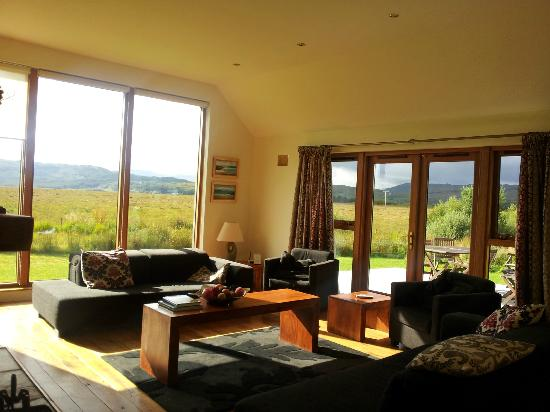 Living room with decking beyond - great views!