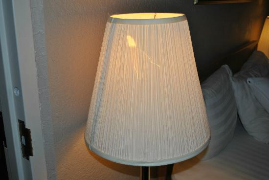 Olympia Resort: Hotel, Spa & Conference Center: Ripped lamp shade in