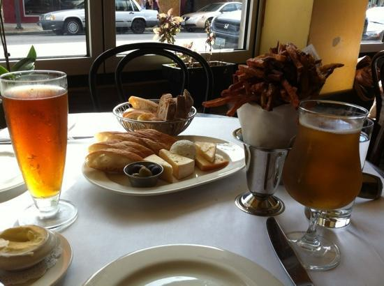 Can Can Brasserie: Beers, breads, cheeseplate, and frites - seated in the window.