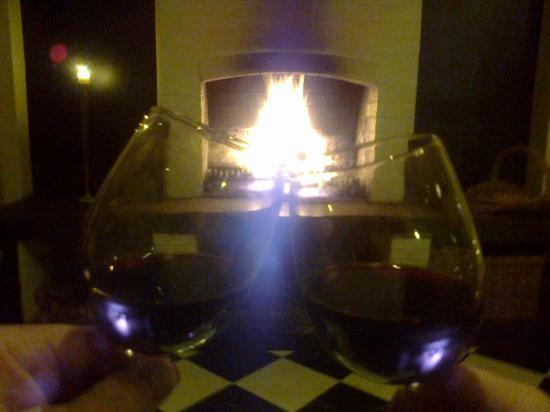 Old Church Restaurant: Enjoying our wine on the comfy lounge in front of the fire place.