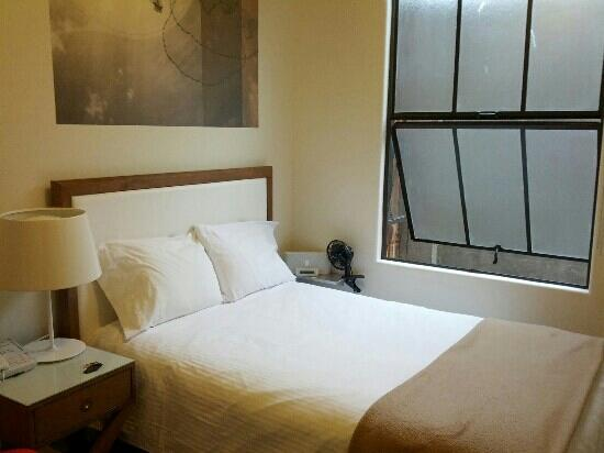 Commodore Hotel: the bed in room 301 (shared bath)