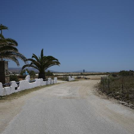 Coralli Beach Apartments: Road outside the hotel, leading to the beach