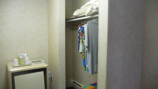 Impala Island Inn: Closet area and mini fridge