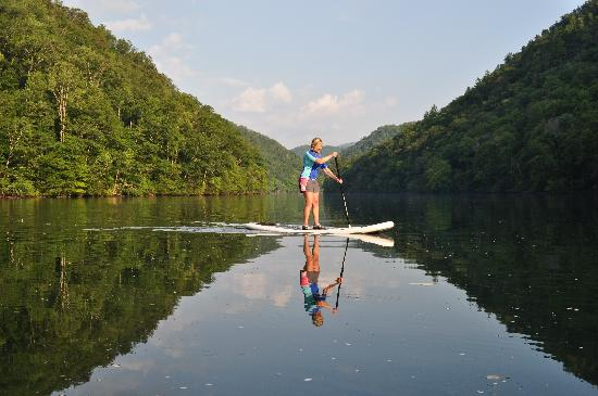 Southern Water Trails LLC: Becky on one of our peaceful mountain lakes.