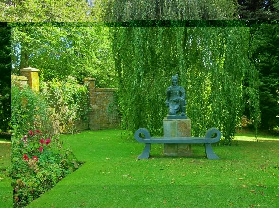 Marle Place Gardens and Gallery: Japanese statue at the end of the herbaceous borders
