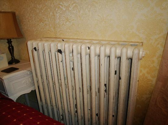 The Sycamore Guest House: Paint Coming Off Of The Heater In The Bedroom.