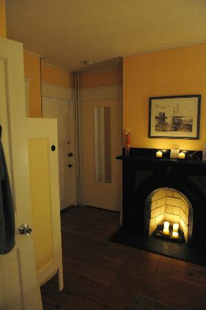 Candlebay Inn: View from bed to front door, sink and fireplace of Bayberry Room