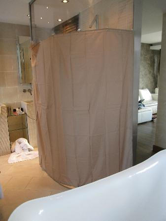Le Dortoir: Shower with the fabric shower curtain we purchased and hung with suction cup hooks...for privacy