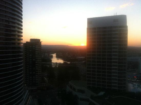 Peppers Broadbeach: Sunset over hinterland from balcony off kitchen.