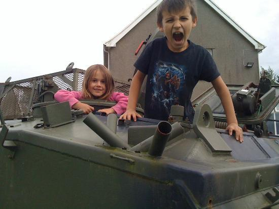 Cimla, UK: Kids enjoying the Tank.