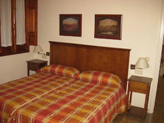 Apartamentos Turisticos San Matias : bedroom with door onto balcony facing the street