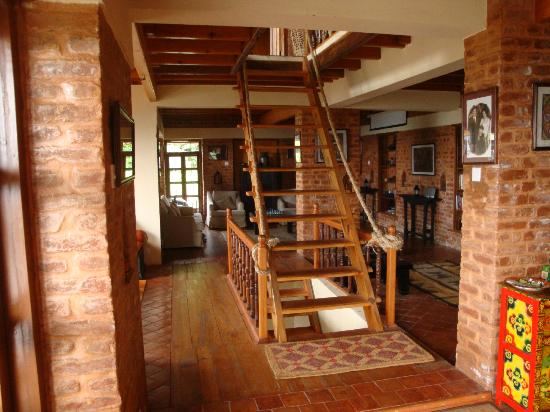 Shivapuri Heights Cottage: Main house - living area and staircase