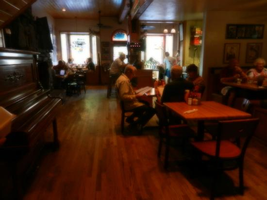 True Grit Cafe: The main floor, rustic & western charm, old upright piano...