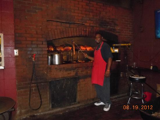 Dreamland Bar-b-que: tending the smoker inside the restaurant
